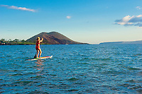 Young woman standup paddling at Makena, Maui