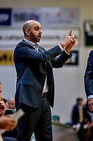 18 December 2019: University of Vermont Catamount Men's Basketball Associate Head Coach Kyle Cieplicki, calls out instructions during second half action against the UNC Greensboro Spartans at Patrick Gymnasium in Burlington, Vermont. The Spartans edged out the Catamounts 54-53 in the final minutes of play. Mandatory Credit: Ed Wolfstein Photo *** RAW (NEF) Image File Available ***