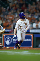 Daniel Cabrera (8) of the LSU Tigers follows through on his swing against the Texas Longhorns in game three of the 2020 Shriners Hospitals for Children College Classic at Minute Maid Park on February 28, 2020 in Houston, Texas. The Tigers defeated the Longhorns 4-3. (Brian Westerholt/Four Seam Images)