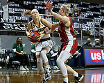 SIOUX FALLS, SD - MARCH 7: Abby Schulte #24 of the North Dakota State Bison is fouled while shooting by Meghan Boyd #0 of the Denver Pioneers during the Summit League Basketball Tournament at the Sanford Pentagon in Sioux Falls, SD. (Photo by Dave Eggen/Inertia)