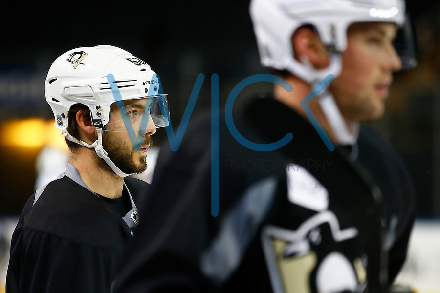 Kris Letang #58 of the Pittsburgh Penguins looks on from the bench during practice at Madison Square Garden in New York City on April 20, 2016. (Photo by Jared Wickerham / DKPS)