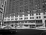 Pittsburgh PA - View of the 700 block of Liberty in Pittsburgh. View of the Clark Building from Wood Street with storefronts; Helfer's Jewelers, Marlane Bridal Shop, Sun Drugs, and Max Azen's Furs.