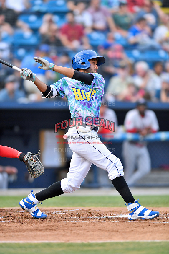 Asheville Hippies shortstop Carlos Herrera (2) swings at a pitch during a game against the Greenville Drive at McCormick Field on June 29, 2017 in Asheville, North Carolina. The Drive defeated the Tourists 9-6. (Tony Farlow/Four Seam Images)