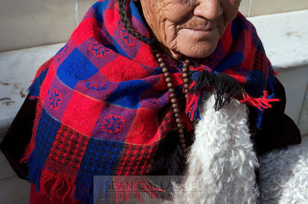 A Tibetan woman in traditional clothing in a small village on the Qinghai-Tibetan Plateau. China