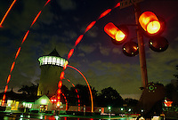Red lights warn of a train's approach near the restored water tower in Riverside. Olmsted and Calvert Vaux's pioneering Chicago suburb offered country living with city conveniences. <br /> <br /> Riverside is a 1,600-acre community along the Des Plaines River west of Chicago. The community has long been considered the best example of Frederick Law Olmsted's idea of how suburbs should look.