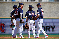 First baseman Tommy White (44), shortstop Termarr Johnson (42), second baseman Kahlil Watson (6), and first baseman Cody Schrier (8) during the Baseball Factory All-Star Classic at Dr. Pepper Ballpark on October 4, 2020 in Frisco, Texas.  (Mike Augustin/Four Seam Images)