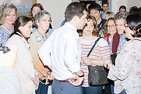 Democratic presidential candidate and South Bend mayor Pete Buttigieg greets people and poses for pictures after speaking at a house party with the Bedford Democrats in Bedford, New Hampshire, on Sat., Apr. 20, 2019. The candidate stood on a chair throughout his speech.