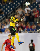 NASHVILLE, TN - JULY 3: Darren Mattocks #10 goes up for a header during a game between Jamaica and USMNT at Nissan Stadium on July 3, 2019 in Nashville, Tennessee.
