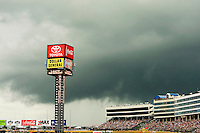 Storm clouds dump rain and delay the race at the Lowe's Motor Speedway, in Concord, NC, during the 2009 Coca-Cola Classic 600 NASCAR race. Driver David Reutimann won his first Cup race during the rain-shortened event, held May 25, 2009. NASCAR's longest scheduled race went only 227 laps, or 340.5 miles, before officials ended it because of rain. The 2009 race was the 50th running of the Coca-Cola 600. Ryan Newman and Robby Gordon finished second and third respectively.