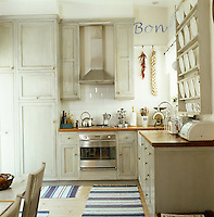 The large family kitchen is painted in a combination of dove grey, white and chalky blue