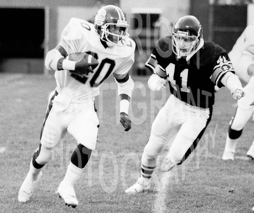 Cedric Minter Toronto Argonauts  And Tim Berryman Ottawa Rough Riders 1981. Copyright photograph Scott Grant