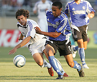 29 June 2005:    Richardo Clark of Earthquakes fights for the ball against Luchi Gonzalez of Rapids during the first half of the game at Spartan Stadium in San Jose, California.   Earthquakes tied Rapids at 0-0 at halftime.   Mandatory Credit: Michael Pimentel / ISI