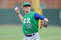 Third baseman Hunter Dozier (13) of the Lexington Legends before a game against the Greenville Drive on Friday, August 18, 2013, at Fluor Field at the West End in Greenville, South Carolina. Dozier was the No. 1 pick (eighth overall) by the Kansas City Royals in the first round of the 2013 First-Year Player Draft. He played collegiate ball for Stephen F. Austin University. Lexington won, 5-0. (Tom Priddy/Four Seam Images)
