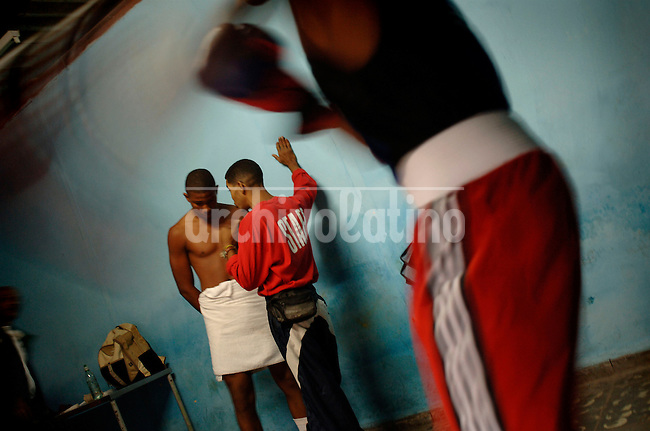 The Rafael Trejo boxing gym is the oldest of Havana, probably the city of the World with champions of the sport. The boys begin their training very young, many of them have no shoes, nor enough food, but they keep going to the gym every day.Maybe  some will be champions. The rest, at least, will be  a little more away from the dangers of the street...