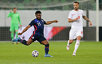 ST. GALLEN, SWITZERLAND - MAY 30: Mark McKenzie #15 of the United States crosses a ball during a game between Switzerland and USMNT at Kybunpark on May 30, 2021 in St. Gallen, Switzerland.