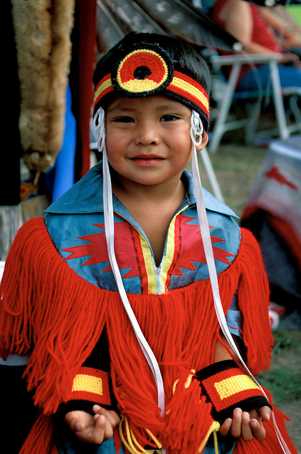 Young Shoshone pow wow dancer dressed in traditional grass dance regalia during the Shoshone Bannock Festival in Fort Hall Idaho