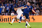 Shibasaki Gaku of Japan (R) fights for the ball with Vahid Amiri of Iran (L) during the AFC Asian Cup UAE 2019 Semi Finals match between I.R. Iran (IRN) and Japan (JPN) at Hazza Bin Zayed Stadium  on 28 January 2019 in Al Alin, United Arab Emirates. Photo by Marcio Rodrigo Machado / Power Sport Images
