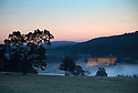 15/08/16<br /> <br /> Shrouded by early morning low cloud, Chatsworth House is illuminated as dawn breaks after a chilly night in the Peak District  this morning, ahead of a forecast week of late summer hot weather.<br /> <br /> This type of weather phenomena is known as an inversion and can occur when, for example, a warmer, less-dense air mass moves over a cooler, denser air mass. This type of inversion occurs in the vicinity of warm fronts.<br /> <br /> All Rights Reserved, F Stop Press Ltd. +44 (0)1773 550665