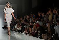 """Una modella presenta una creazione della sfilata della finalista del progetto """"Who is on next?"""" Greta Boldini durante la rassegna Altaroma a Roma, 8 luglio 2013.<br /> A model wears a creation by Greta Boldini, finalist of """"Who is on next?"""" project, at the Altaroma fashion week in Rome, 8 July 2013.<br /> UPDATE IMAGES PRESS/Virginia Farneti"""