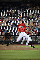 Nick Burdi #19 of the Louisville Cardinals pitches during Game 2 of the 2014 Men's College World Series between the Vanderbilt Commodores and Louisville Cardinals at TD Ameritrade Park on June 14, 2014 in Omaha, Nebraska. (Brace Hemmelgarn/Four Seam Images)