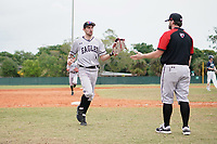 Edgewood Eagles center fielder Bryan Sternig (1) greeted by coach Ralph Kalal on the way back to the dugout during the first game of a double header against the Bethel Wildcats on March 15, 2019 at Terry Park in Fort Myers, Florida.  Bethel defeated Edgewood 6-0.  (Mike Janes/Four Seam Images)