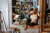 A man sits in his workshop in the Chandni Chowk electronics market in Kolkata.<br /> <br /> To license this image, please contact the National Geographic Creative Collection:<br /> <br /> Image ID: 1925745 <br />  <br /> Email: natgeocreative@ngs.org<br /> <br /> Telephone: 202 857 7537 / Toll Free 800 434 2244<br /> <br /> National Geographic Creative<br /> 1145 17th St NW, Washington DC 20036