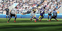 Pictured: Referee Chris Foy (L) the moment he got knocked over by a Fabricio Coloccini of Newcastle  (C FRONT)deflection from a Jonjo Shelvey (C BACK) shot of Swansea. Saturday 19 April 2014<br /> Re: Barclay's Premier League, Newcastle United v Swansea City FC at St James Park, Newcastle, UK.