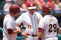 Florida State Seminoles head coach Mike Martin #11 (center) talks with Tyler Holt #15 and Rafael Lopez #29 during the Championship Game of the 2010 ACC Baseball Tournament at NewBridge Bank Park May 30, 2010, in Greensboro, North Carolina.  The Seminoles defeated the Wolfpack 8-3.  Photo by Brian Westerholt / Four Seam Images