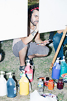 People paint in the protest area in FDR Park  outside of the secure area surrounding the Democratic National Convention at the Wells Fargo Center in Philadelphia, Pennsylvania, on Wed., July 27, 2016.