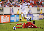 18 July 09: Brad Evans (US) leaps Panama's Luis Moreno to go for the ball during the U.S. 2-1 overtime win in the CONCACAF Gold Cup Quarterfinals at Lincoln Field In Philadelphia, Pennsylvania.