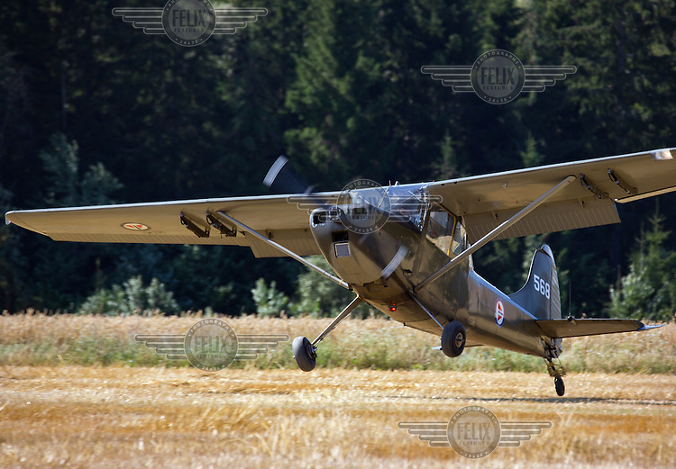 Bird Dog landing in a field. <br /> <br /> Airplanes and reenactors photographed at in connection with Høytorptreffet, an annual event at the Høytorp fort. <br /> <br /> Høytorp fort is a barrage fort in the Glomma defence line, built 1912-17. On April 13th and 14th 1940 the fort was in combat against German army units . It is now protected as a national monument.<br /> <br /> ©Fredrik Naumann/Felix Features