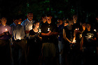 September 11, 2011; Following the mass of remembrance for the 911 attack victims, students and guests gather at the Grotto for individual prayer at the University of Notre Dame. Photo by Barbara Johnston/University of Notre Dame