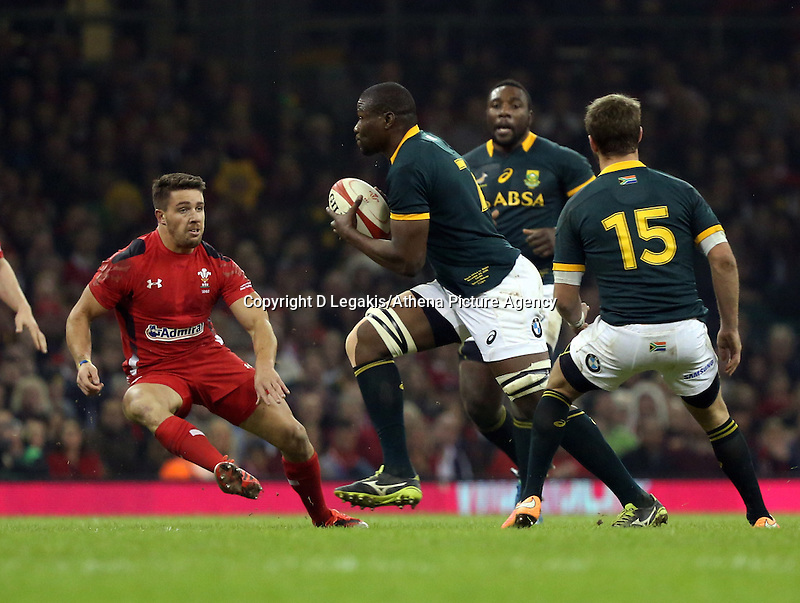 Pictured: Teboho Mohoje of South Africa (C) against Rhys Webb (L) of Wales Saturday 29 November 2014<br /> Re: Dove Men Series 2014 rugby, Wales v South Africa at the Millennium Stadium, Cardiff, south Wales, UK.