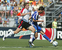 Fulham FC's Moritz Volz (left) chases Major League Soccer's Clint Dempsey (right) during the MLS All Star game in Columbus, Ohio Saturday, July 30, 2005.