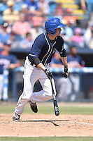 Asheville Tourists left fielder Eric Toole (9) swings at a pitch during a game against the Hagerstown Suns and the  at McCormick Field on September 5, 2016 in Asheville, North Carolina. The Suns defeated the Tourists 9-5. (Tony Farlow/Four Seam Images)