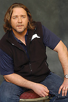"RUSSELL CROWE.Photocall for ""3:10 To Yuma"", Rome, Italy..October 16th, 2007.three ten 310 3 10 half length black sleeveless top blue t tee shirt sitting stubble facial hair .CAP/CAV.©Luca Cavallari/Capital Pictures."