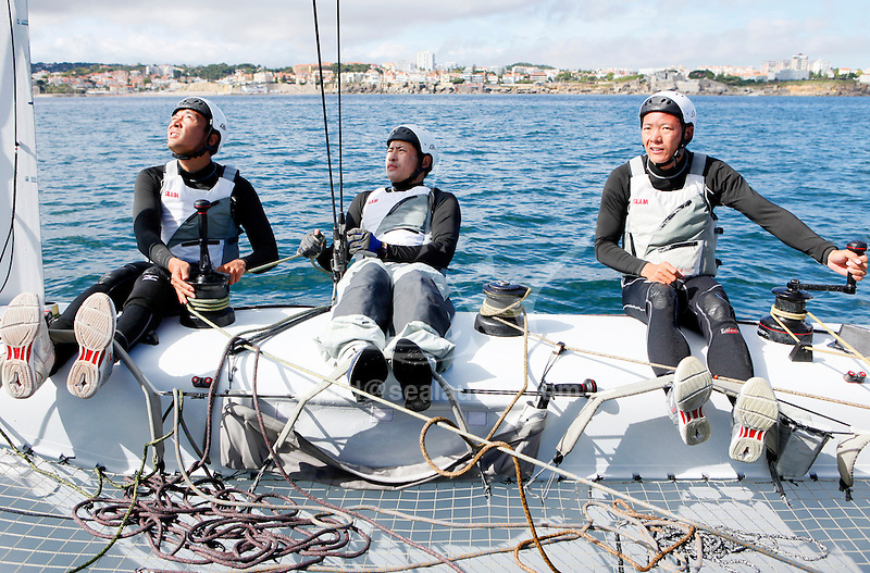 Onboard the AC 45 China Team 1 during a training session in Cascais Portugal before the start of the America's Cup World Series..Cheng Ying Kit.Wu Liang William.Liu Cheng Qi Larry
