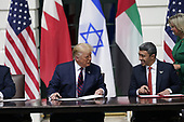 """From left to right: nited States President Donald J. Trump and Sheikh Abdullah bin Zayed bin Sultan Al Nahyan, Minister of Foreign Affairs and International Cooperation of the United Arab Emirates sign the """"Abraham Accords"""" on the South Lawn of the White House in Washington, DC on Tuesday, September 15, 2020. <br /> Credit: Chris Kleponis / Pool via CNP"""