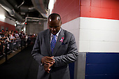 Houston, Texas<br /> October 2, 2011<br /> <br /> Checking his watch before entering the lockroom just before the game, general manager and first as executive vice president, Rick Smith oversees all aspects of football operations. Smith has strengthened Houston's roster through the draft, free agency and several trades at key positions.<br /> <br /> The Houston Texans defeated the Pittsburgh Steelers at the Reliant Stadium 17 to 10.