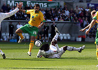 ATTENTION SPORTS PICTURE DESK<br /> Pictured: Jason Scotland of Swansea falls on the ground after the foul by Simon Lappin of Norwich (L) which earned the former a penalty kick<br /> Re: Coca Cola Championship, Swansea City FC v Norwich City FC at the Liberty Stadium Swansea, south Wales. Saturday 11 April 2009.<br /> Picture by D Legakis Photography / Athena Picture Agency, Swansea 07815441513