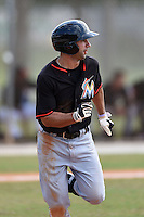 Miami Marlins infielder Anthony Gomez (13) during a minor league spring training game against the New York Mets on March 28, 2014 at the Roger Dean Stadium Complex in Jupiter, Florida.  (Mike Janes/Four Seam Images)