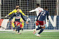 FOXBOROUGH, MA - OCTOBER 16: Ryan Spaulding #34 of New England Revolution II defends as Edwin Munjoma #26 of North Texas SC prepares to take a shot on goal during a game between North Texas SC and New England Revolution II at Gillette Stadium on October 16, 2020 in Foxborough, Massachusetts.