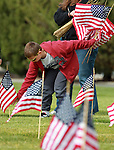 Nick Arraiz, 9, places flags on the graves of veterans at the Lone Mountain Cemetery in Carson City, Nev., on Friday, May 25, 2012. Volunteers from the D.A.V., American Legion, Carson High School ROTC and Boy Scout Troop 145 placed more than 1,400 flags on the graves of veterans in honor of Memorial Day..Photo by Cathleen Allison