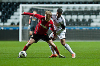 Monday 20 January 2014<br /> Pictured: ( L-R )  Jernade Meade and Kenji Gorre battle for the ball <br /> Re: Swansea City U21 v Cardiff City U21 at the Liberty Stadium, Swansea Wales
