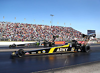 Sep 2, 2017; Clermont, IN, USA; NHRA top fuel driver Tony Schumacher (near) races alongside Brittany Force during qualifying for the US Nationals at Lucas Oil Raceway. Mandatory Credit: Mark J. Rebilas-USA TODAY Sports