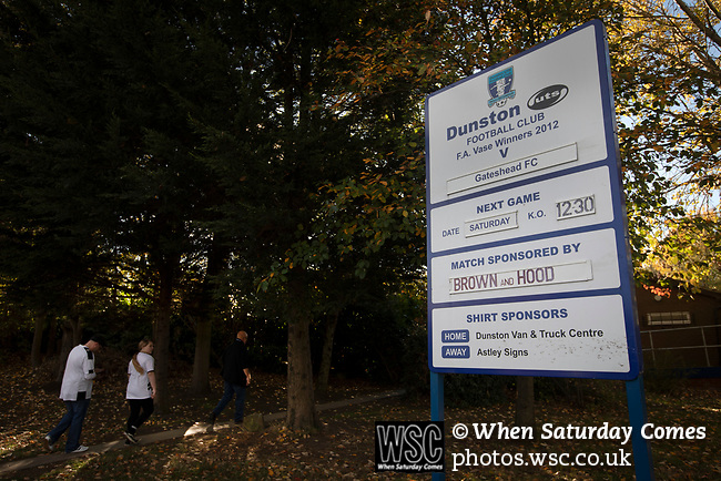 Visiting supporters arriving at the UTS Stadium before the FA Cup fourth qualifying round match between Dunston UTS and their local rivals Gateshead. Founded in 1975, the home team were formerly known as Dunston Federation. The visitors won 4-0 watched by a record crowd of 2,500.