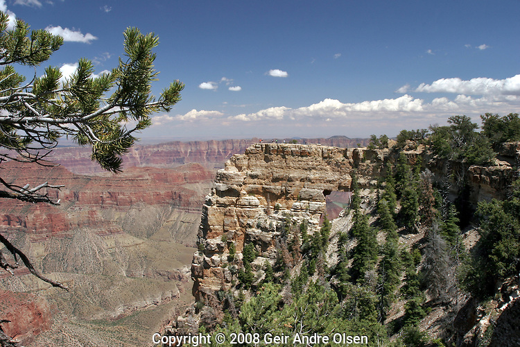 Some tourists on top of Angels Window at the Cape Royal Point overlook in the Grand Canyon National Park in the USA