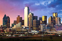 """""""Dallas Skyline at Dusk"""" - Illuminated by a blend of ambient and artificial light, the glowing sunset shimmers off the glass and architecture of the Dallas skyline. As the sun prepares to dip below the horizon, Bank of America Plaza (center left) reflects tertiary colors of orange, pink, and yellow while lights on the iconic Reunion Tower (centered) flash and sparkle, bringing the city to life as the night quickly approaches.  (Copyright © 2016 Stephen A. Masker. All Rights Reserved.)"""