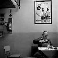 Gordon drinks a beer at the Harlequins Sport Bar on Pretoria Street.