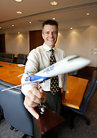 Benjamin Boehm, Director Program Management Office NEW COMMERCIAL AIRCRAFT PROGRAM, hold a model of CRJ 800, Bombardier biggest plane so far.